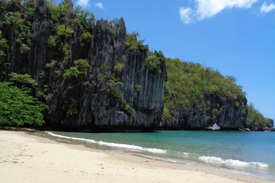 WORLD HOLIDAY TRAVEL AND TOURS Adventure Package Puerto Princesa: D Lucky Garden Inn Room + tours