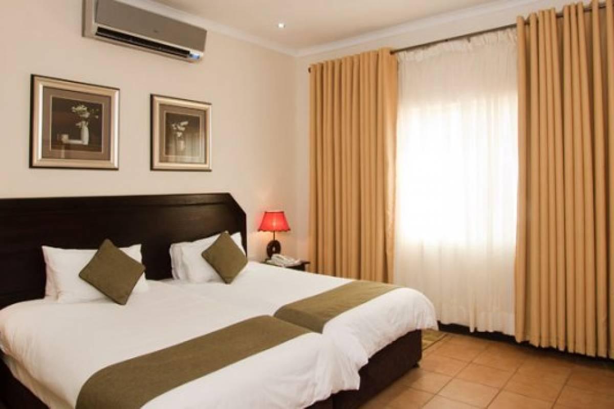 e-Tourism t/a SimplyTravel Oasis Motel