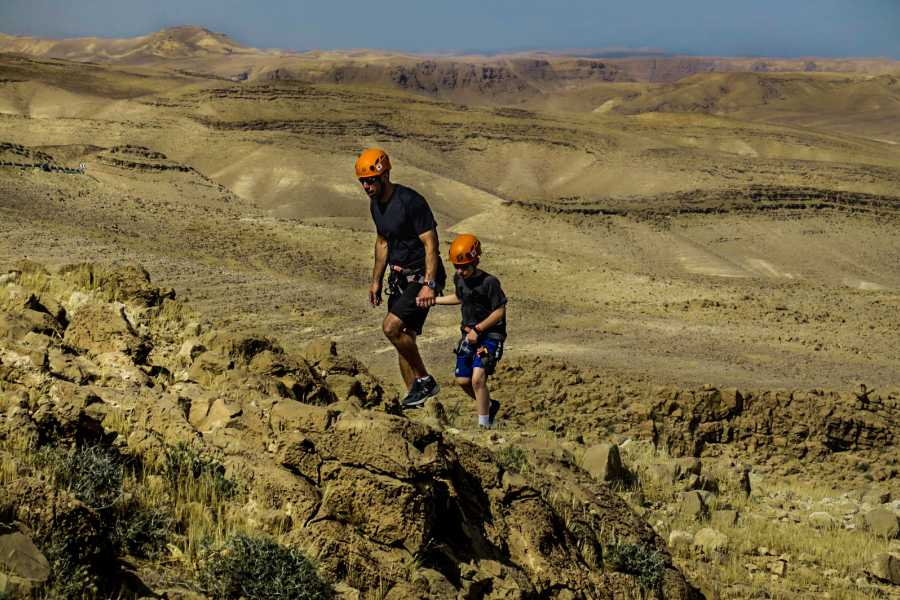 Desert-Pass Family rappelling activity - Kidod Canyon
