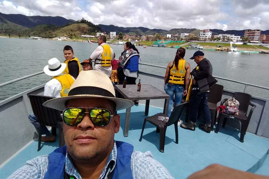 Medellin City Tours VIP P.E. w C13, barrio pe, museum, memory house, and Guatape with boat ride 18 hrs