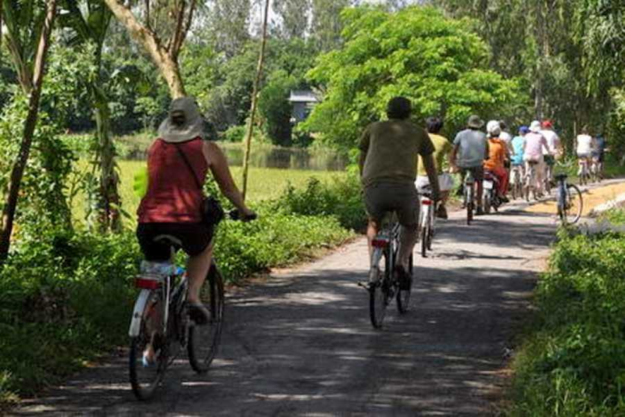 Vietnam 24h Tour Cu Chi Tunnel Bike & Boat full day