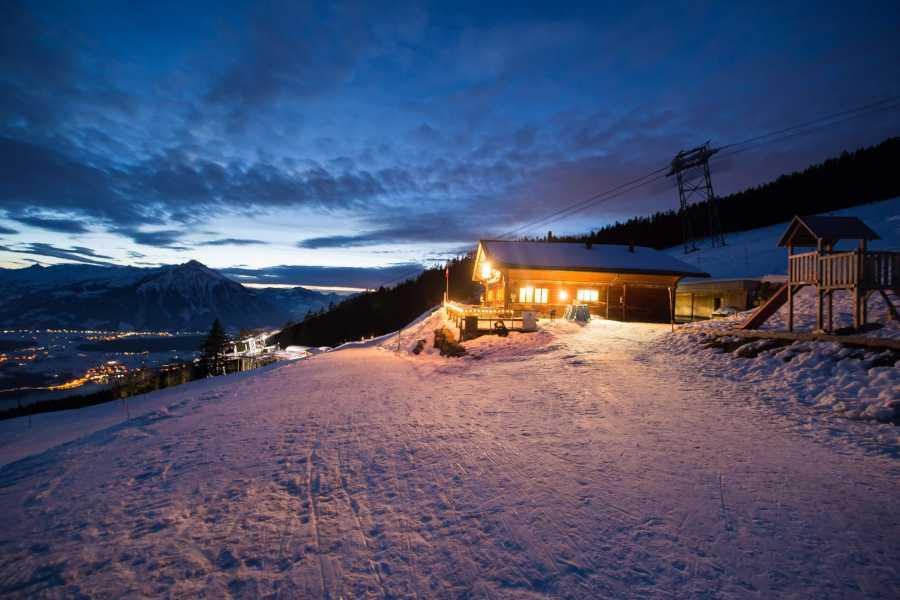 Interlaken Tourismus Sledging by starlight with fondue at Niederhorn