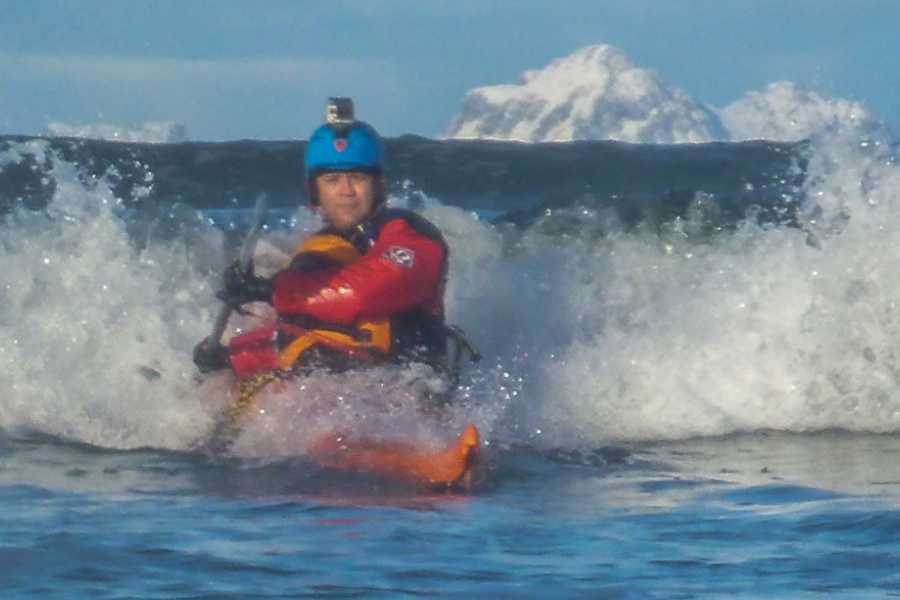 Lofoten Aktiv AS Jann's surfing in a seakayak
