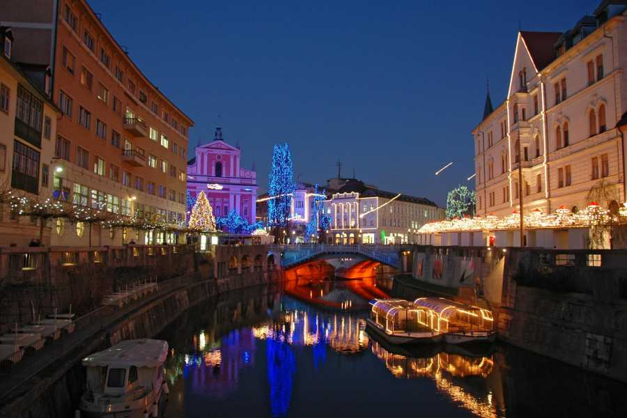 ToDoInSlovenia, brand of Kompas d.d. LJUBLJANA BY NIGHT - WALKING TOUR AND BOAT RIDE
